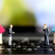image of figurines of commercial real estate agents social distancing